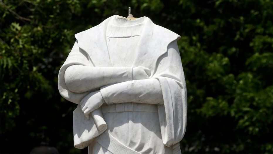 Christopher Columbus statues torn down, drenched in paint, defaced ...